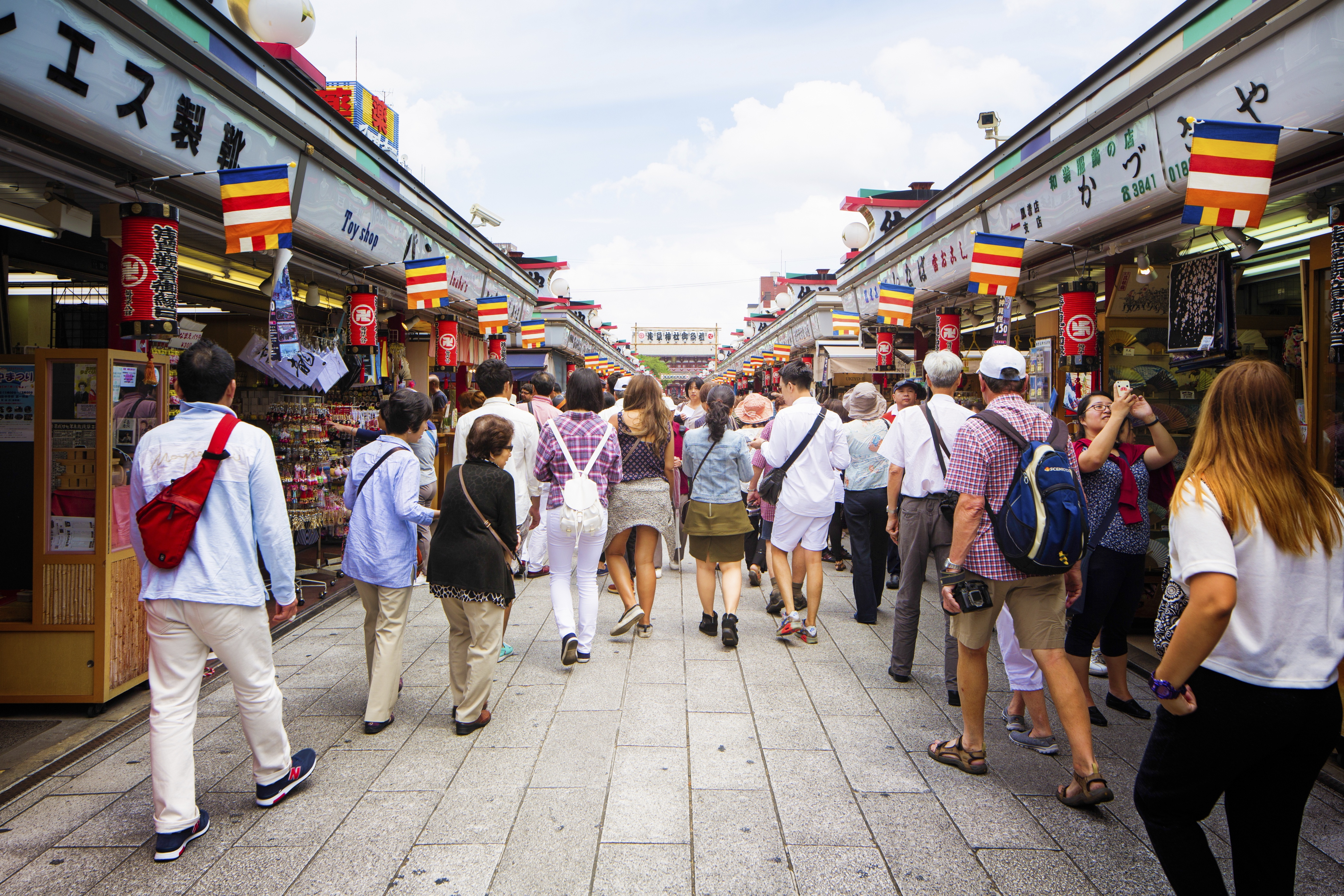 Shoppers and tourists walking on Asakusa Nakamise shopping street Tokyo