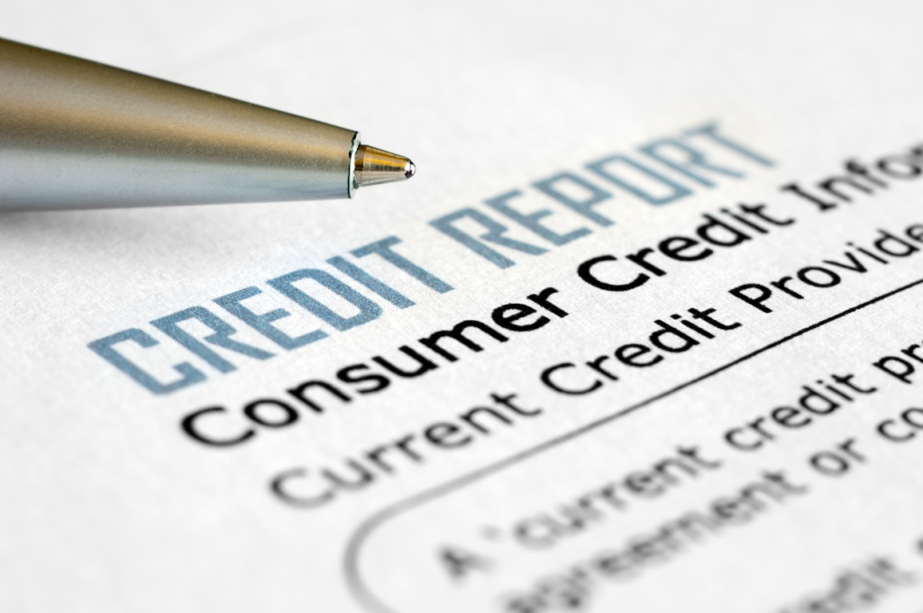Close-up of credit report with pen