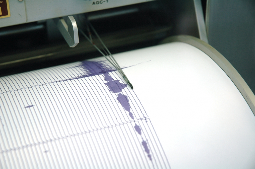 A seismograph records data.