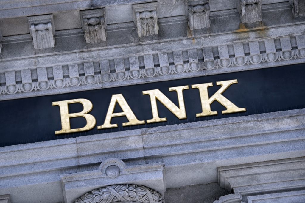 An old fashioned 'Bank' sign on a building exterior.