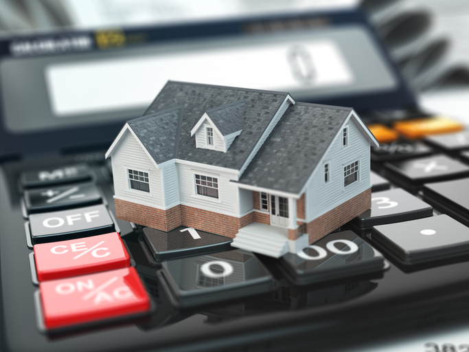 Mortgage calculator. House on buttons. Real estate concept. 3d