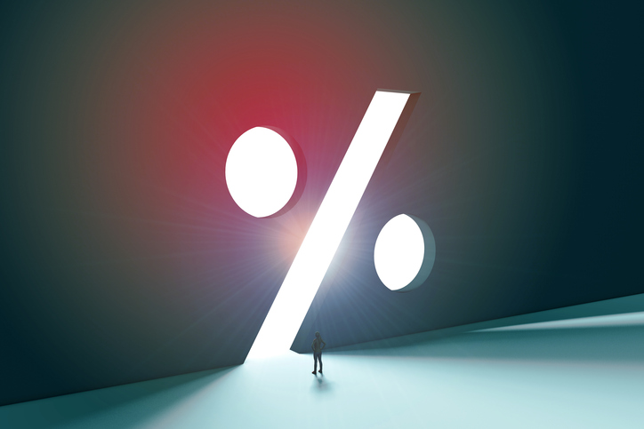 A 3D render of a female figure in front of a bright percentage sign opening. Bright light is behind the doorway creating a silhouetted shape. The person is standing looking toward the future opportunity ahead.