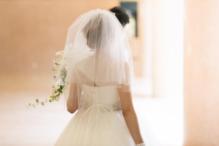 Bride walking into bright room